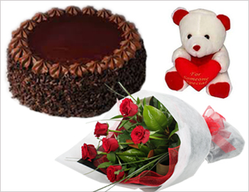 1/2 kg Cake (Chocolate) with 6 Red Roses and a small Teddy Bear: When great events call for something really grand, send this extraordinary combination of Teddy Bear, Cake and Roses.