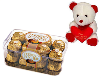 Small Teddy Bear and a Box of Ferrerorochers (16 pcs.): A variant combination of Cute Cuddly Teddy Bear and a box of 16 pcs world famous Ferrerorochers.
