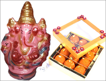 Eco-Friendly Ganesha With Motichoor Laddu: Gift this Ganesha made of natural clay and colours (approx 12 HT) along with 500 gms Motichoor Laddu.