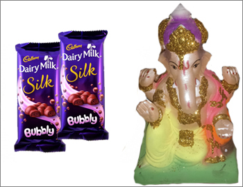 Eco-Friendly Ganesha With Dairy Milk Silk Bubbly: Gift this Ganesha made of natural clay and colours (approx 12 HT) along with 2 Dairy Milk Silk Bubbly.