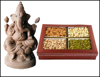 Eco-Friendly Ganesha With Assorted Kova Sweets: Gift this Ganesha made of natural clay and colours (approx 12 iches height) along with 250 gms Assorted Kova Sweets.