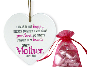 Ceramic Heart Shaped Hanging with a Bag of Chocolates: Thank mommy for showering you with love all her life by presenting her this ceramic heart quotation and a small puch of chocolates(5 pcs) on this mothers day. A distinct way to show your love for her, this quotation with a hanging loop will be a beautiful addition to her room (Height  15.3 cm X Length  14 cm X Width  0.8 cm).