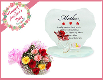 Charming Heart Shaped Glass Gift Article with Mixed Roses Bunch: Thank mommy for all her love in a special way as you gift her this charming glass quotation. A lovely way to tell her how lucky you feel to have her in your life, this quotation adorned with a lovely quote is sure to put a smile on her face every time shell glance at it (Height  9cm X Length  11cm) . And 6 Mixed Roses Bunch.