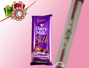 Pearls Beautiful Rakhi with  Silk: Beautiful Pearls rakhis that are beaded, diamond studded ,Cadbury Dairy Milk Silk(80gm) and made with love.