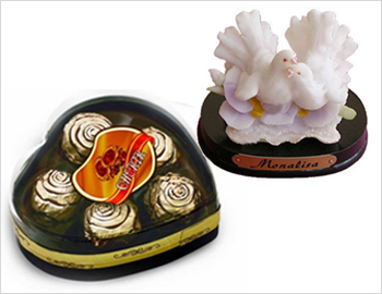 Love Birds Gift Article With Cherir Chocolate Box: Gift article depicting two white love birds on a marble stone of around 6 inches height along with Cheriar (Five Pieces) chocolate box.