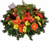 Mixed Flowers Round Bunch; Combination of mixed seasonal flowers and greens to express your condolence message across, at a sad time.