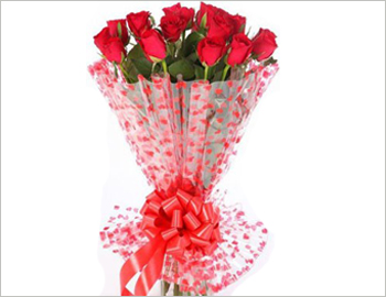 Bunch of 12 red roses; A lovely round hand bouquet of 12 red roses, with fillers - appropriate for any occasion.