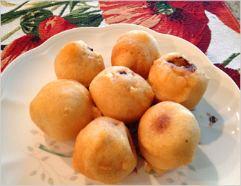 Boorelu; Boorelu is a Traditional Andhra Special Sweet prepared during Festivals. Boorelu is also called as Poornalu. This Golden Sweet ball has a yummy poornam inside which is covered by a dough, fried in oil.