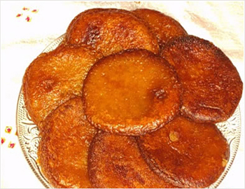Ariselu; Made with rice flour, sweetened and stuffed with either jaggery or sugar, these sweets are circular in shape.