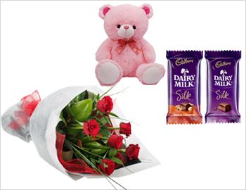 Bunch of Roses with Teddy and Dairy Milk Silk Chocolates: Bunch of six red roses along with teddy bear (6 inch) and Cadburys Diary Milk Silk Chocolates (2 nos) - each 60 gms