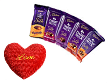 Heart-shaped Cushion along with Milk Silk Chocolates: Small heart-shaped cushion and five variaties of Dairy Milk Silk Chocolates (each 60 gms)