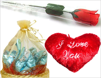 Heart-shaped Cushion and Artificial Rose with Chocolates: Small heart-shaped cushion, small artificial red rose and a bunch of six imported chocolates