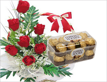 Bunch of Roses with Box of Ferrero Rochers: Bunch of six red roses along with Box of 16 pcs Ferrero Rochers Chocolates.
