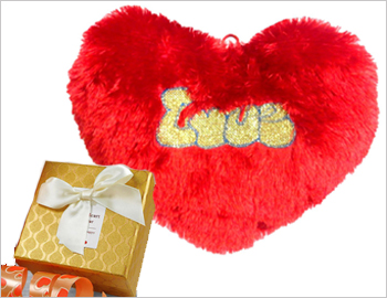 Heart-shaped Cushion with Chocolate Box: Let your heartfelt feelings be expressed with this small chocolate box (mocha chocolates or cadburys celebrations) and adorable heart-shaped cushion.